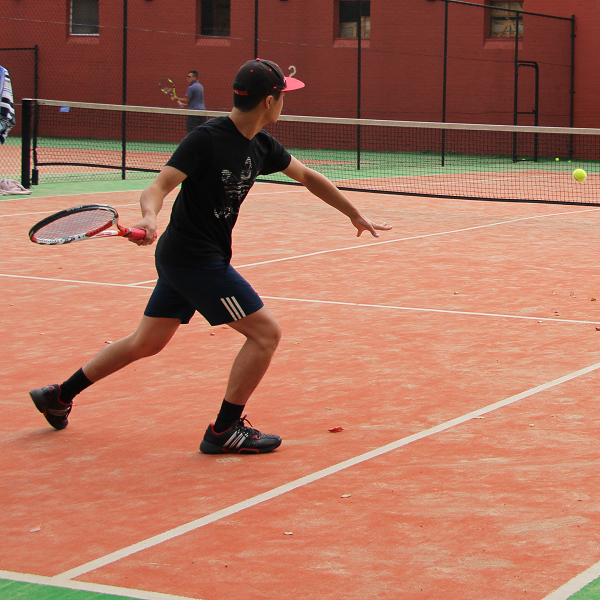 Marcus hitting forehand at Social Tennis